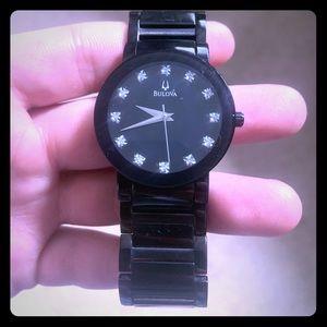 Black Bulova watch w/ diamonds in the watch face